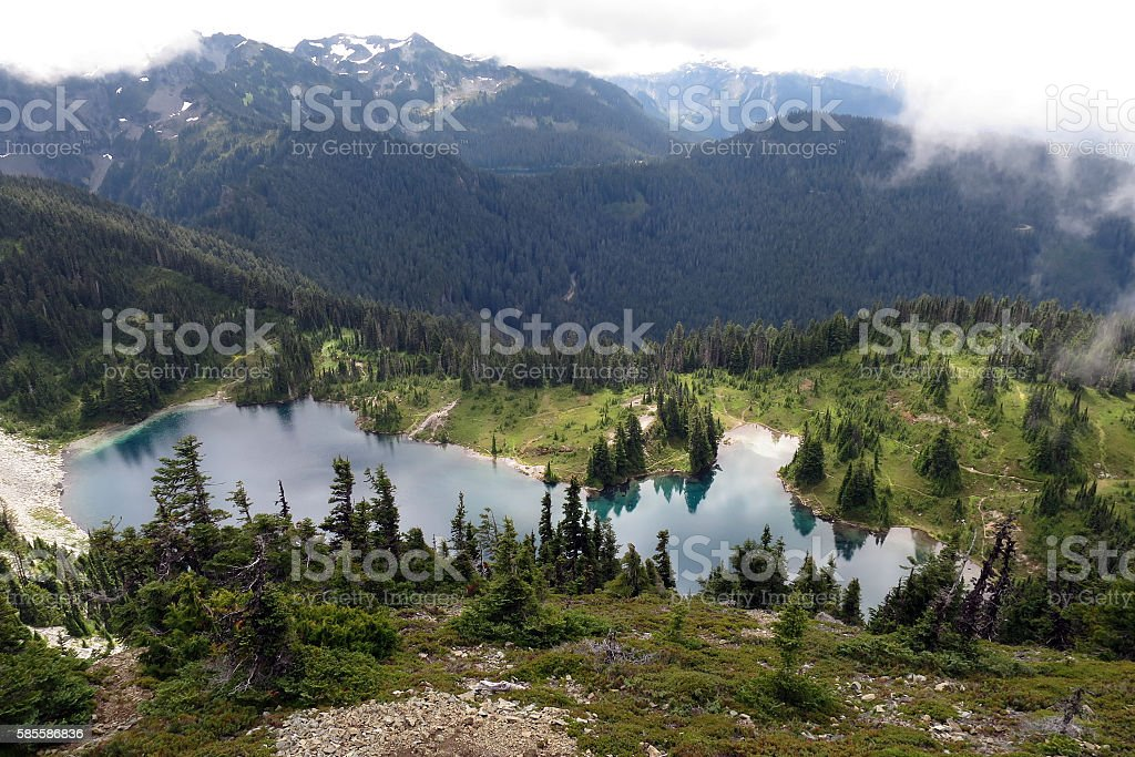 Alpine Lake in the Clouds stock photo