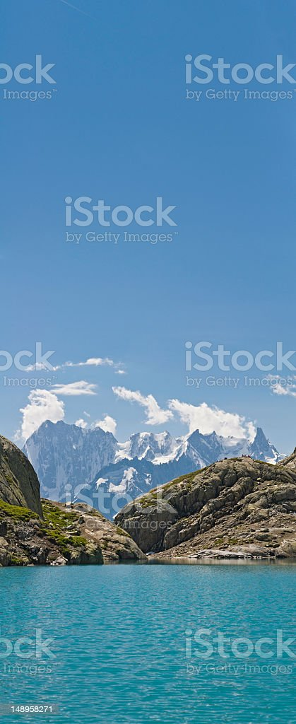 Alpine lake snow peak vertical royalty-free stock photo