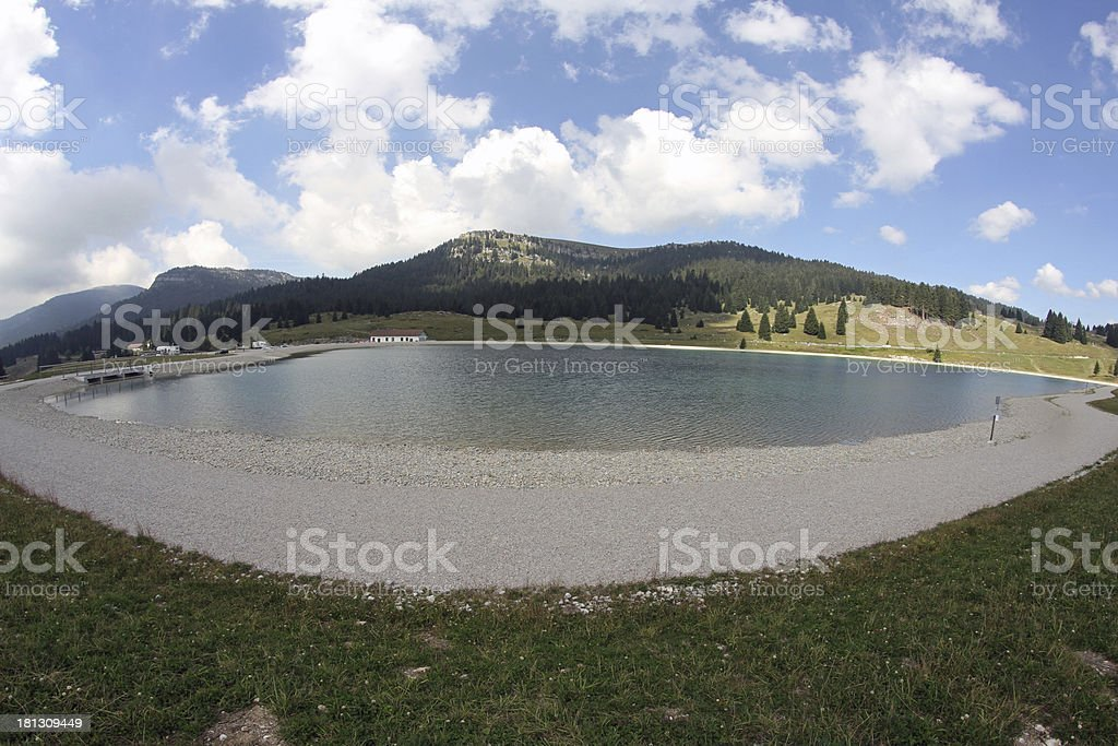 alpine lake surrounded by high mountains royalty-free stock photo