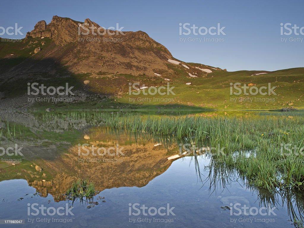 Alpine lake with mountain range reflection royalty-free stock photo