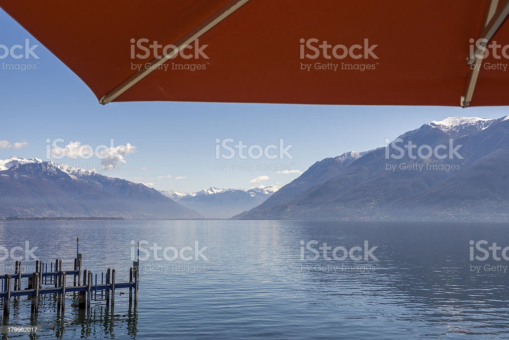 Alpine lake with parasol royalty-free stock photo