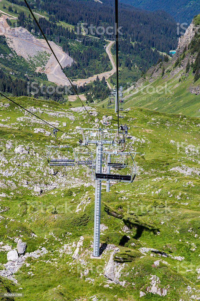 alpine landscape in summer with chair lift, Alps mountain Switzerland stock photo