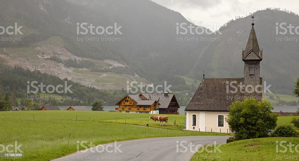 Alpine landscape with church and cows, Bad Aussee Austria. stock photo