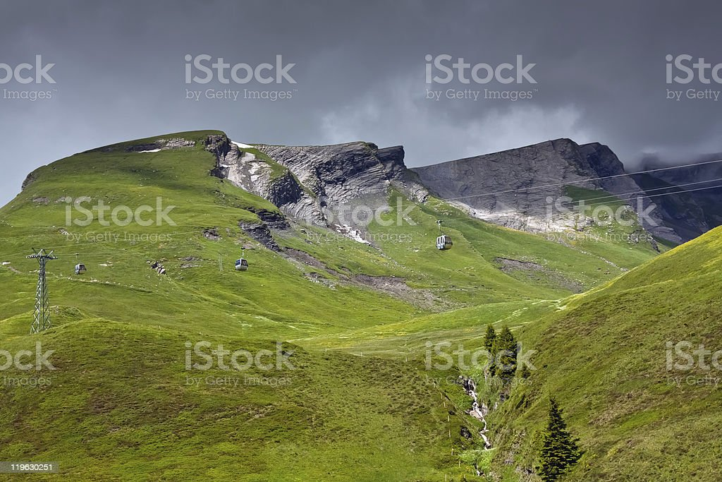 Alpine landscape with funicular, Grindelwald - Bernese Alps - Switzerland royalty-free stock photo