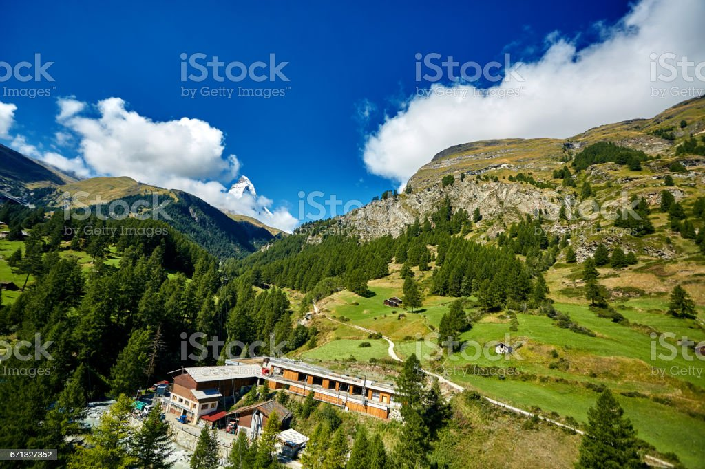 Alpine meadow with houses stock photo