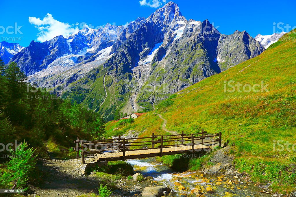 Alpine paradise! Mont Blanc landscape meadow, bridge, trail, Aosta stock photo