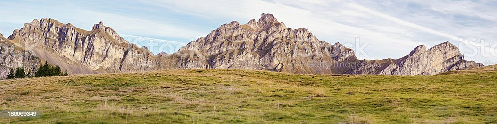 Alpine pasture with mountain range panorama royalty-free stock photo