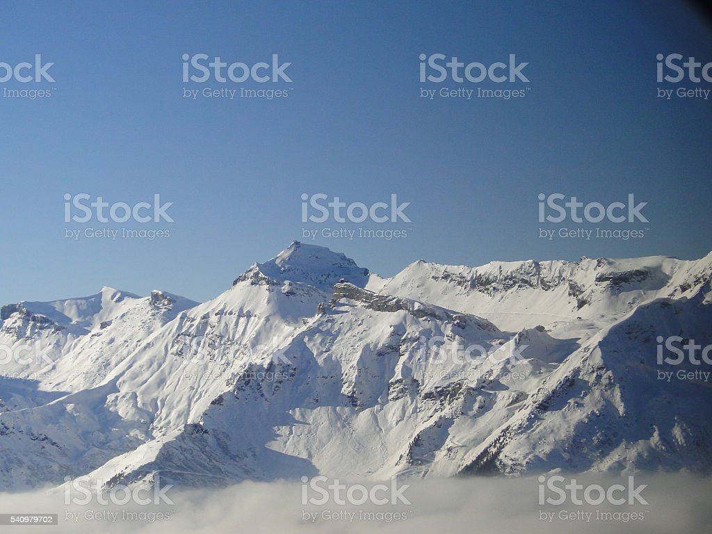 Alpine Peaks Above the Clouds in Mürren, Switzerland stock photo