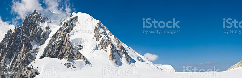 Alpine peaks climbers blue sky high royalty-free stock photo
