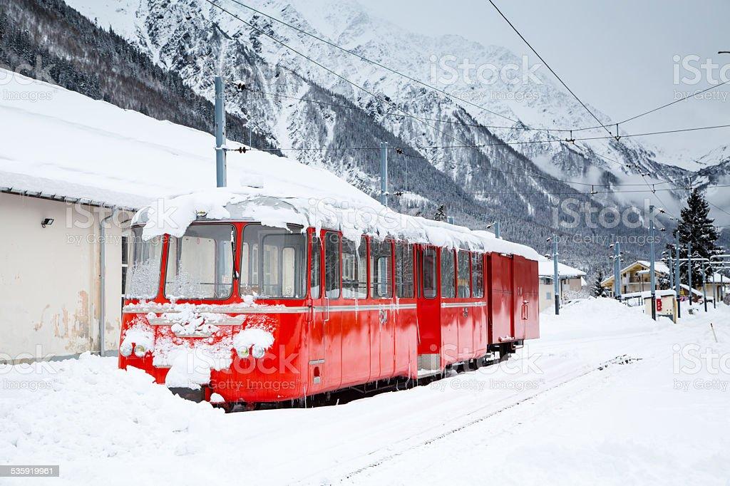 alpine red train Montenvers Mer de Glace in snow stock photo