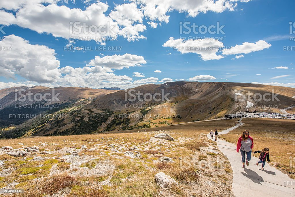 Alpine ridge trail in Rocky Mountains with people hiking stock photo