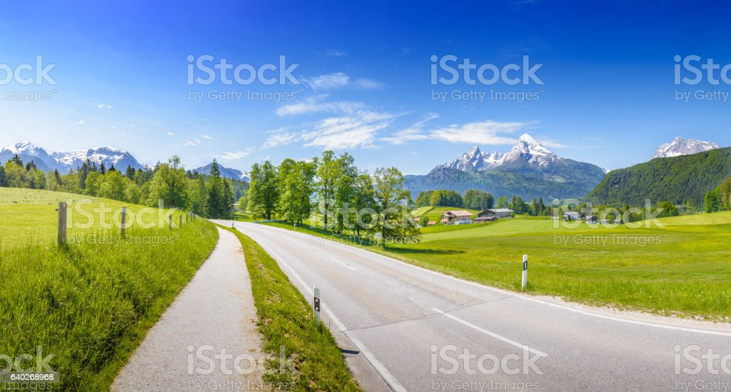 Alpine road in front of snowy Watzmann stock photo
