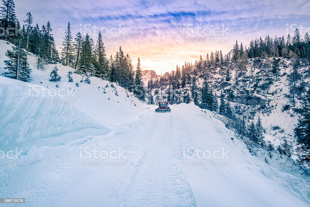 Alpine road mapped out in snow, Austria stock photo