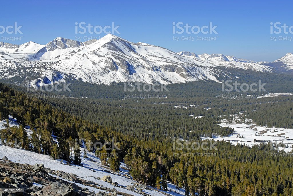 Alpine scene with snow capped mountains in Yosemite National Park stock photo
