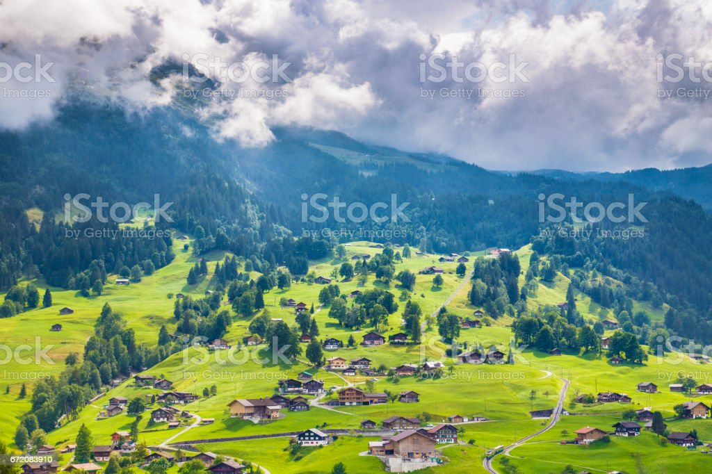 Alpine scenery with traditional mountain chalets in Grindelwald, Switzerland stock photo
