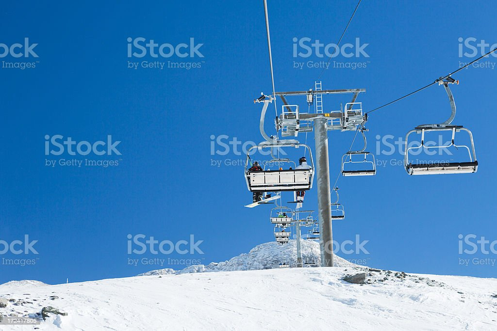 Alpine ski Lift in winter resort stock photo