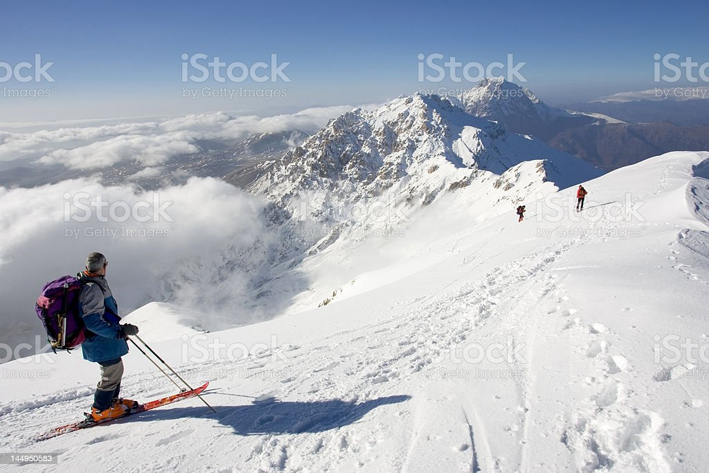 alpine skiers on the top of a mountain royalty-free stock photo