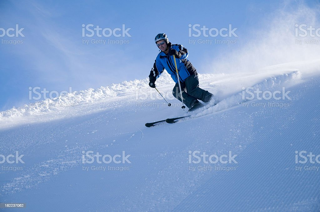 skier with helm on the slope