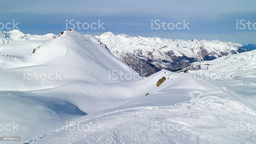 Alpine snowy peaks panorama from ski slope stock photo