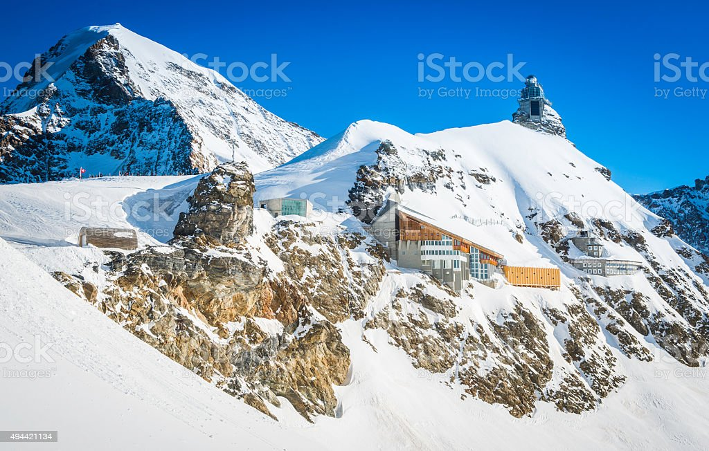 Alpine station and observatory high on mountain peaks Jungfraujoch Switzerland stock photo