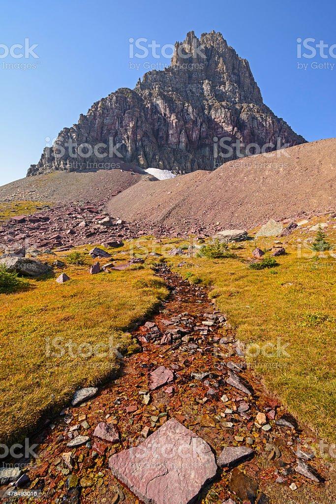 Alpine Stream Below a Isolated Peak stock photo