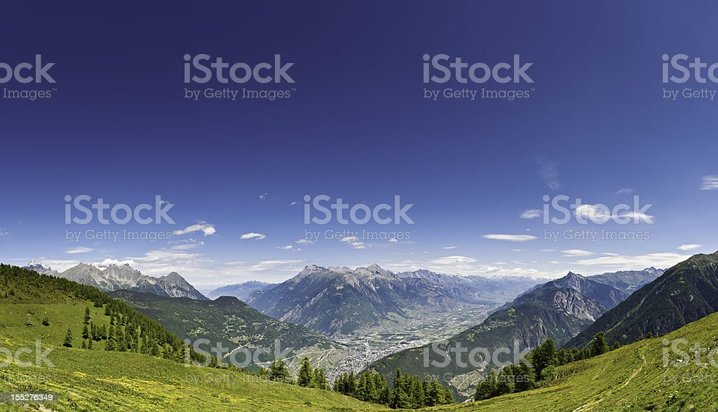 Alpine summer mountain meadow panorama Switzerland stock photo