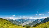 Alpine summer mountain meadow panorama Switzerland