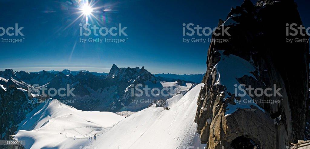 Alpine summit sunburst stock photo