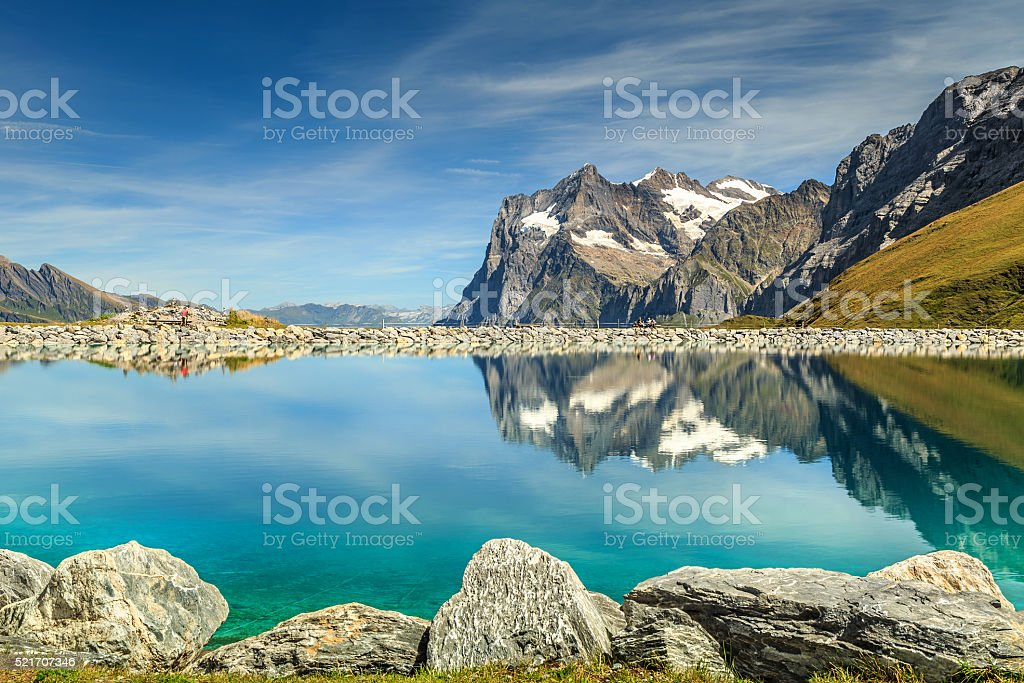 Alpine turquoise lake and high mountains,Bernese Oberland,Switzerland stock photo