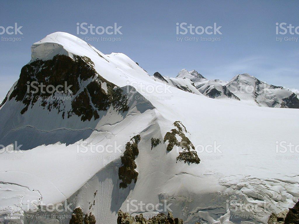 alpine view of snow capped mountain peak royalty-free stock photo