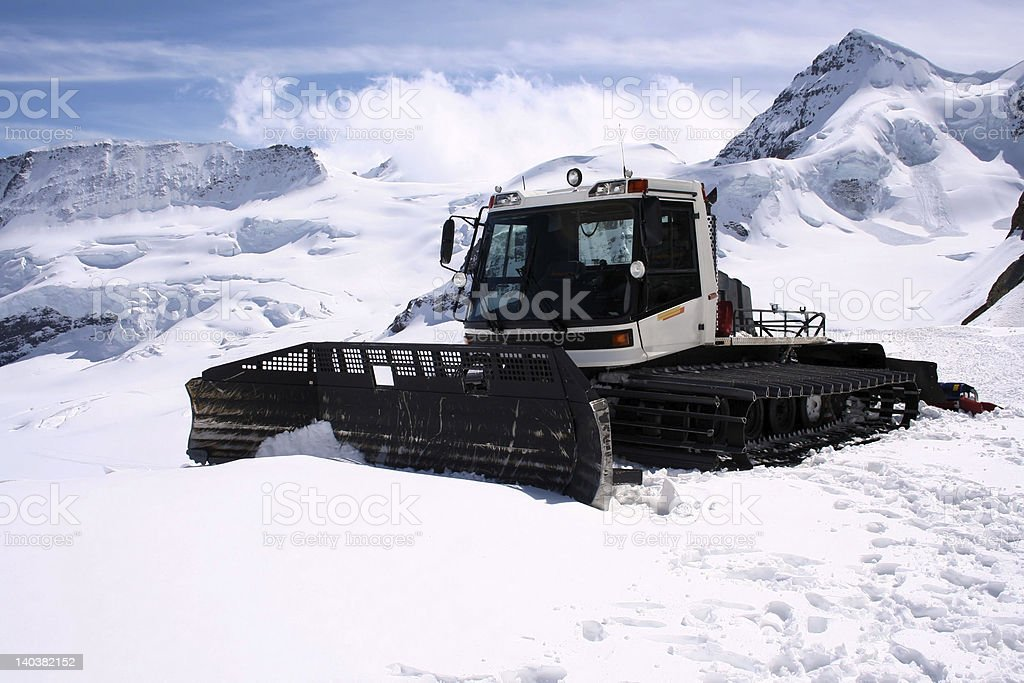 'Alpine view', Snowplow in the Swiss Alps royalty-free stock photo