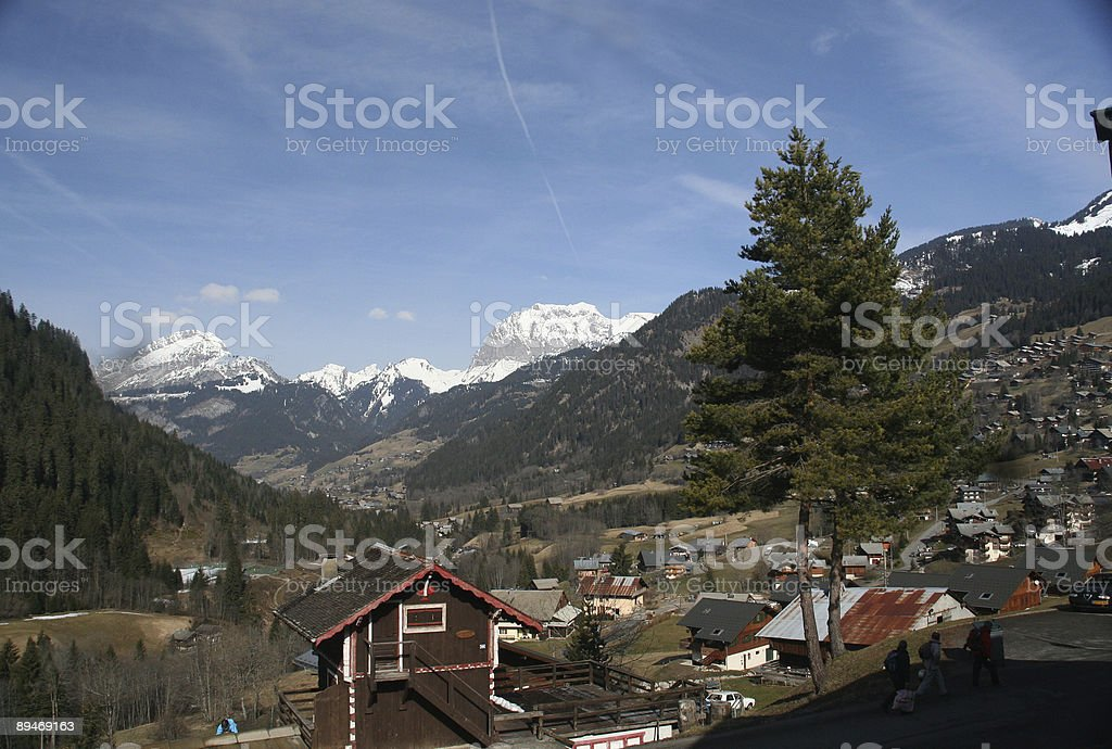 Alpine village and valley stock photo