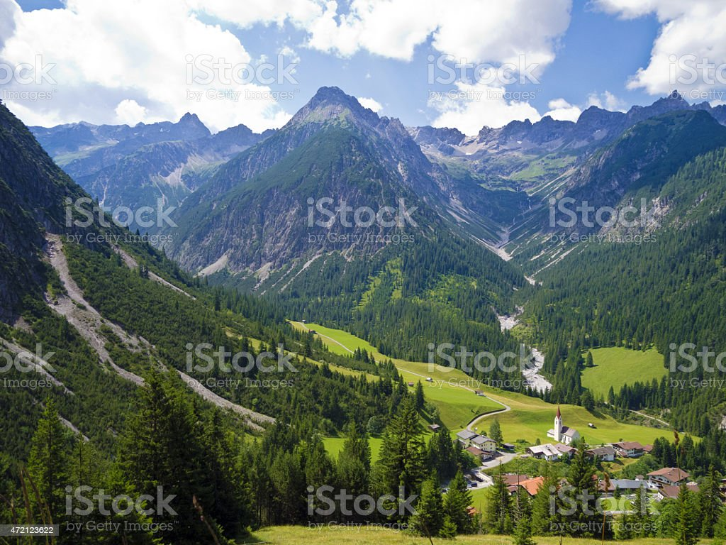 alpine village in the valley stock photo