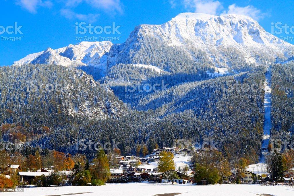 Alpine village in Waxenstein Bavarian Alps, idyllic Pine trees woodland under snow landscape, majestic alps valley, dramatic Bavaria german Snowcapped mountain range panorama, Berchtesgaden alps, Germany stock photo
