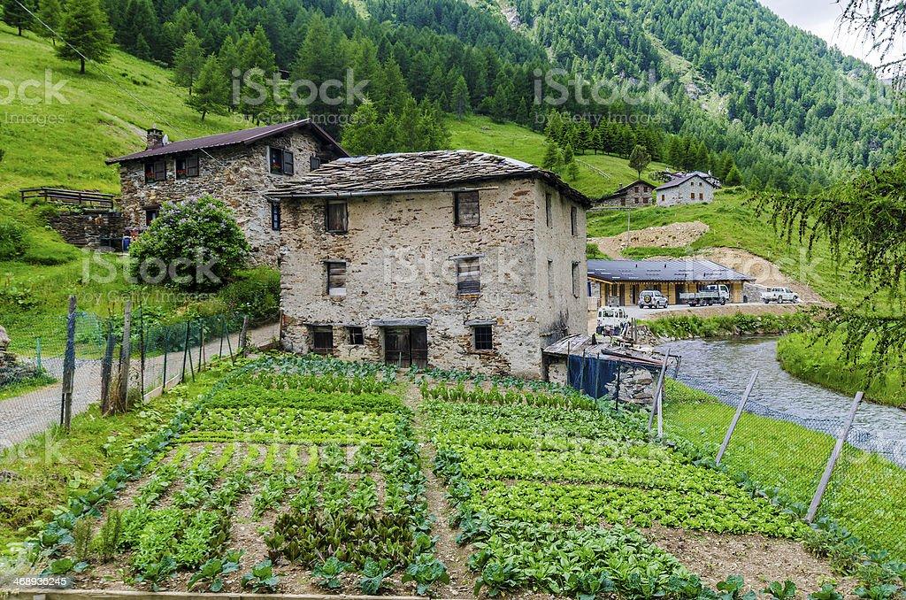 Alpine Village stone shepherd's hut in valley of the Alps stock photo