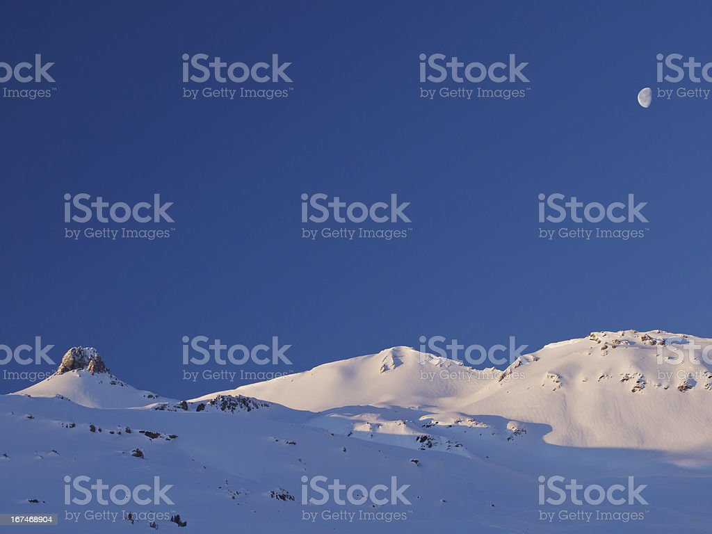 Alpine winter landscape with moon royalty-free stock photo
