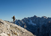 Alpinist enjoying the View from the Top of the Alps