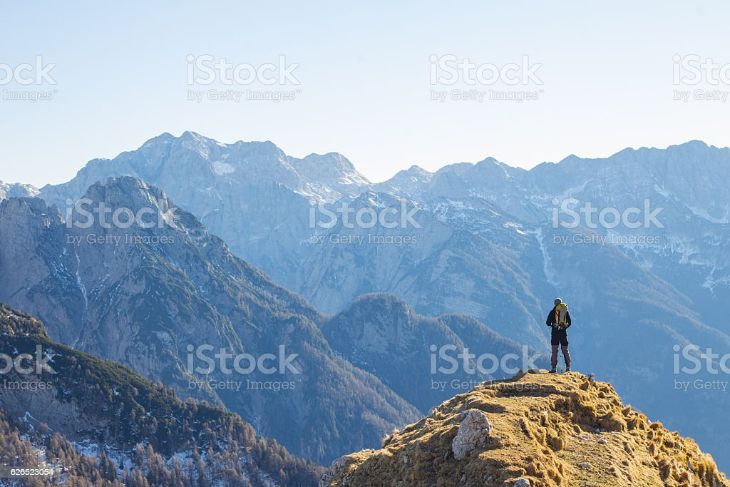 Alpinist Enjoying the View Over the Mountains in the Alps stock photo