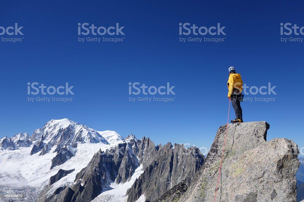 Alpinist facing Mont Blanc stock photo