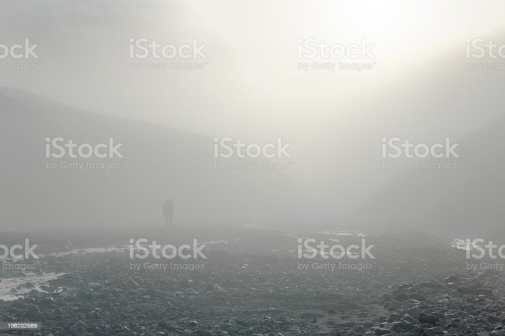 Alpinist in a mist royalty-free stock photo