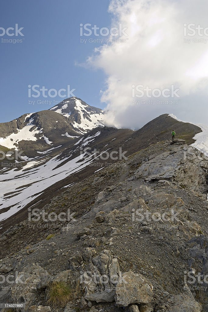 Alpinist on the mountain ridge royalty-free stock photo