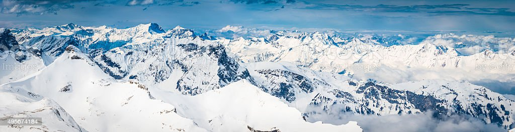 Alps aerial panorama over jagged mountain peaks snowy summits Switzerland stock photo