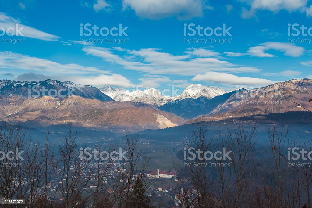 Alps and town below. stock photo