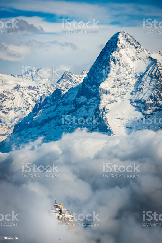 Alps Birg cable car station through clouds below Eiger Switzerland stock photo
