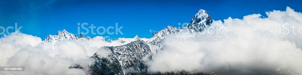Alps Chamonix Aiguilles snowy mountain summits panorama above clouds France stock photo