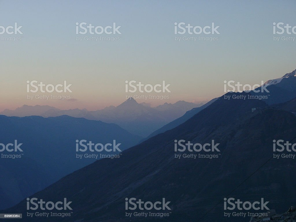 Alps, early morning first rays of sun over mountain ridge royalty-free stock photo