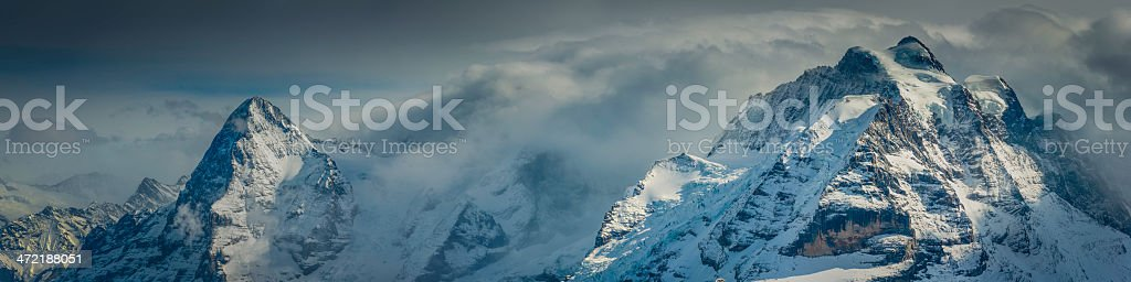 Alps Eiger and Jungfrau dramatic snowy mountain peaks panorama Switzerland stock photo