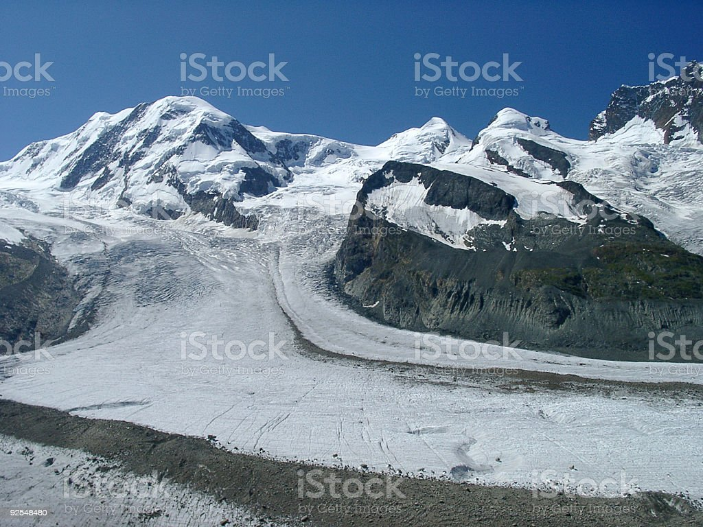Alps, glacier and snow filled mountain valley royalty-free stock photo
