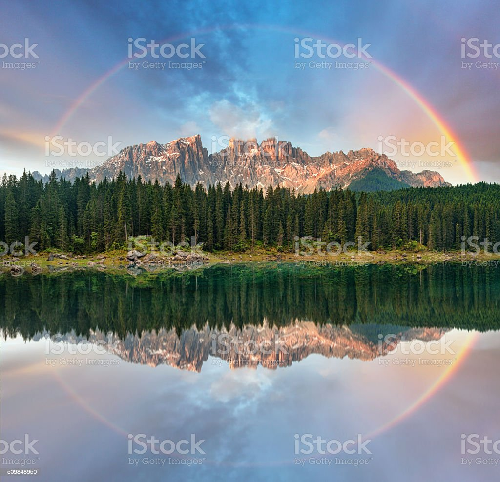 Alps Lake with rainbow - Lago di Carezza, Italy stock photo