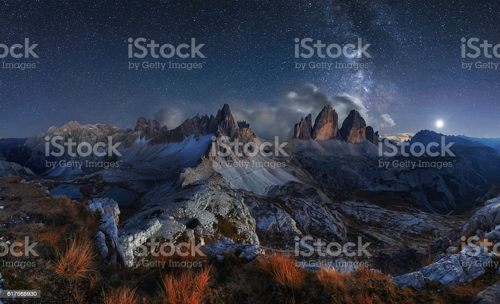 Alps Mountain landscape with night sky and Mliky way, Dolomites stock photo